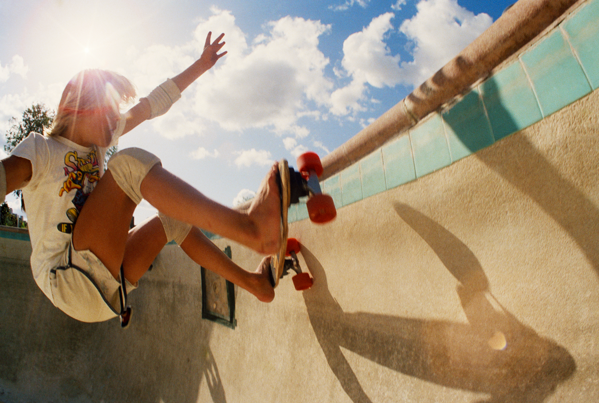 Hugh Holland photograph of kid on skateboard in swimming poo