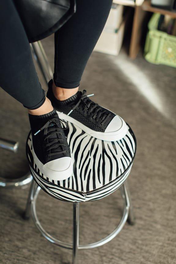 The Jefferson 2.0 Liteknit resting on a zebra print stool