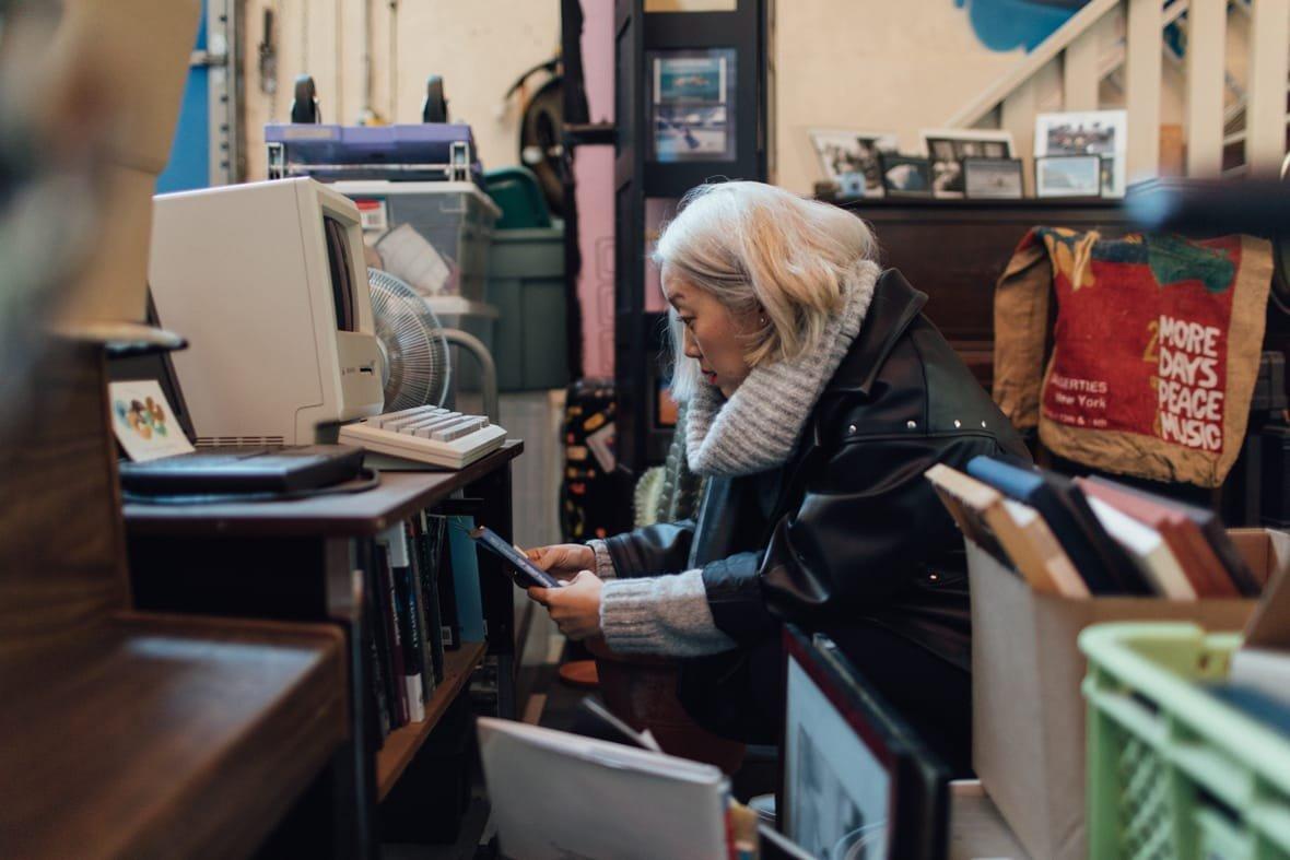 Oribu Yokota sifting through projects in her studio