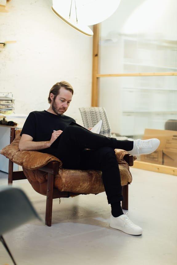 An ANDlight designer sitting in a chair wearing the Jefferson 2.0 Liteknit