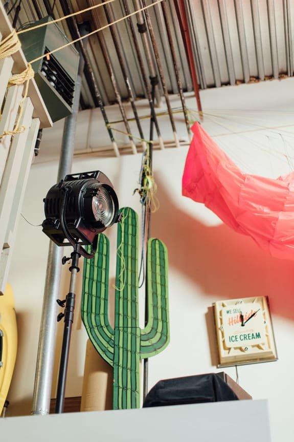 Oribu Yokota's studio showing a large light and a cactus sign