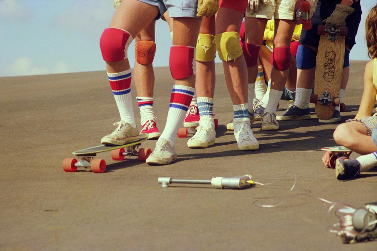 1970's Hugh Holland image of skateboarders wearing tube socks and knee pads