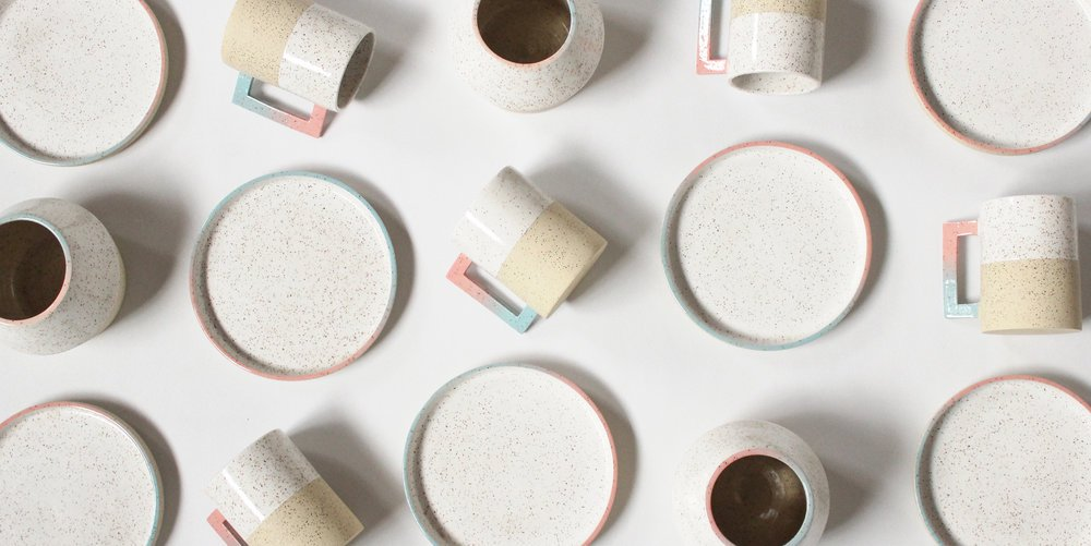 view of multiple cups, coasters and bowls