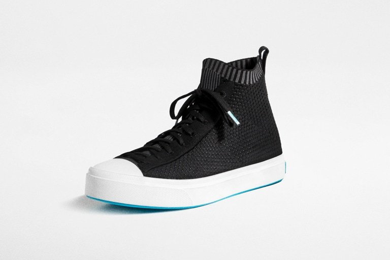 Image of the Jefferson high in black showing features such as recycled insole zero waste production, ultra light outsole and slip on knit technology.