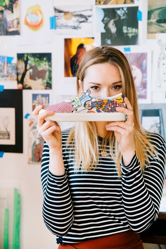 Ola Volo holding her Native Shoes print collaboration shoe.