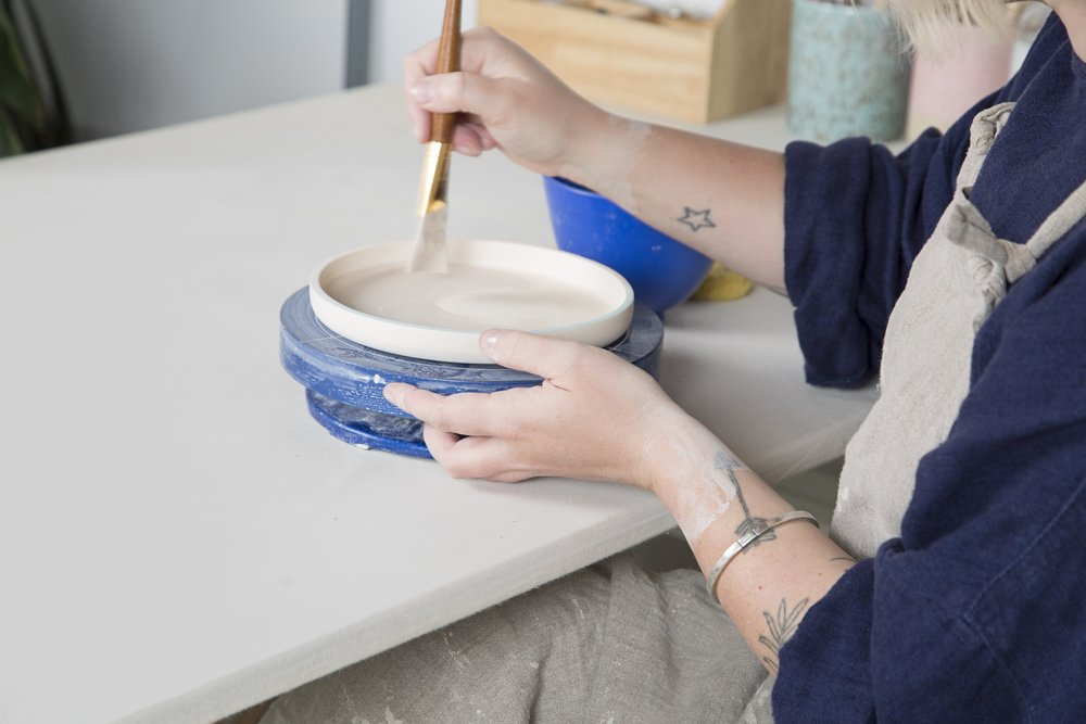 close-up view of woman making pottery