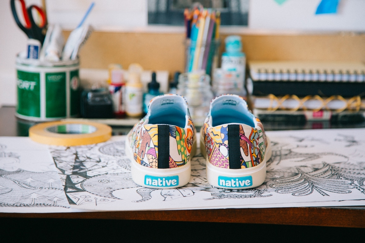 Native Shoes Ola Volo print collaboration shoes sitting on sketches in her studio.