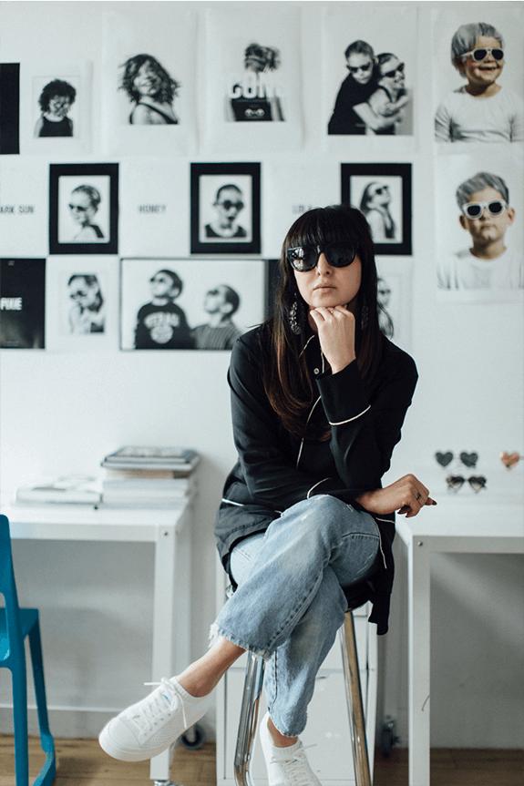 Shiva Shabani wears heart-shaped glasses in her studio.