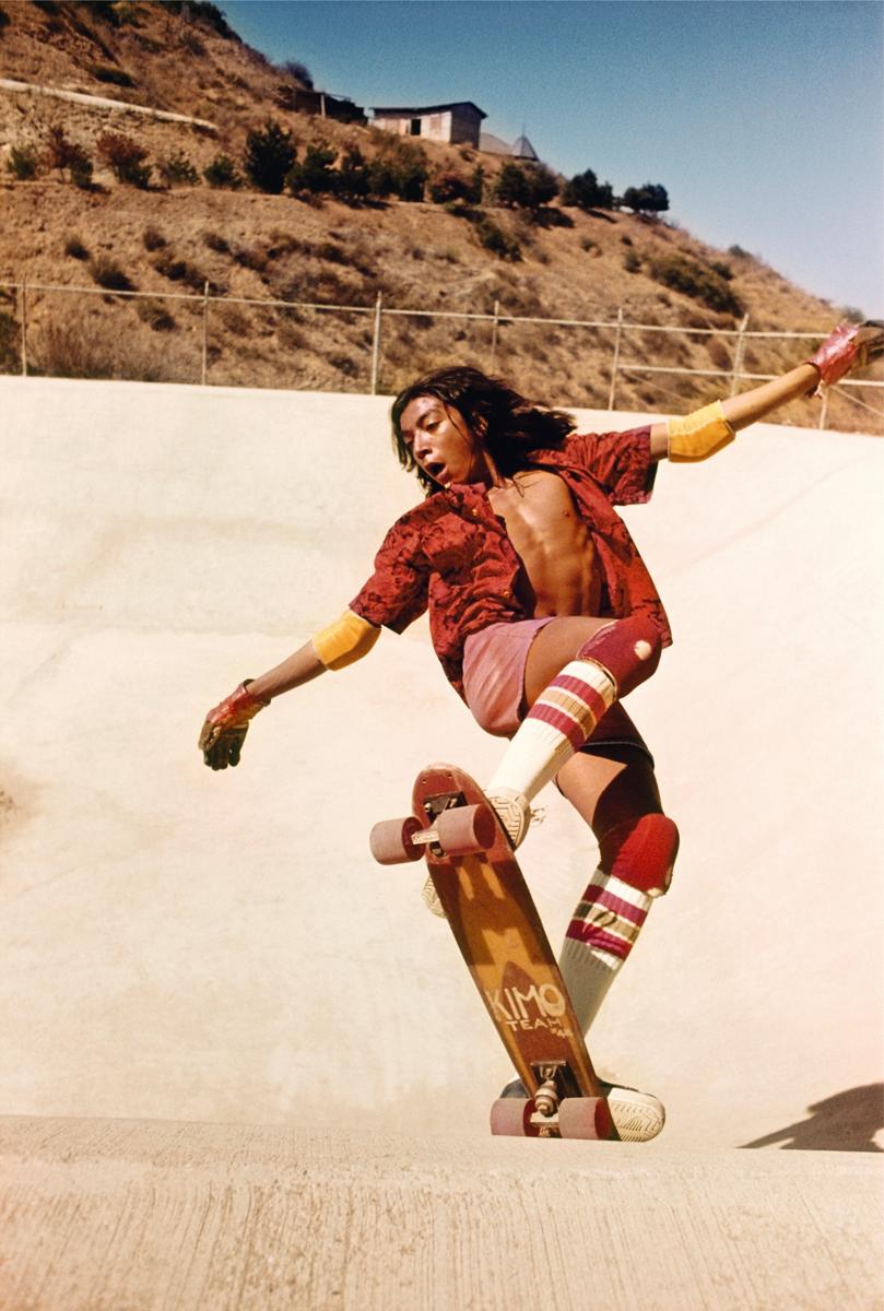 Hugh Holland photograph of kid on skateboard in swimming pool