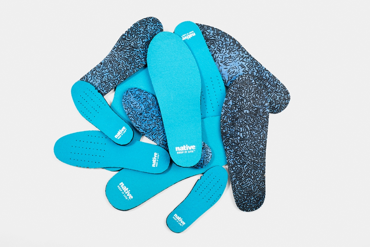 Pile of sneaker insoles made with sustainable recycled fibres
