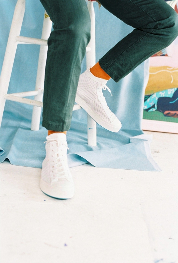 Wearing Native Shoes Jefferson 2.0 high in white on pale blue backdrop
