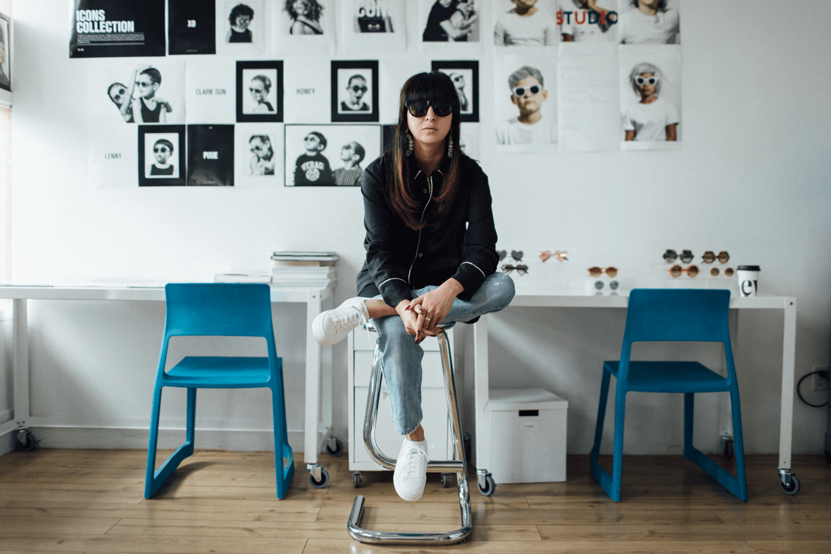 Shiva Shabani wears the Native Shoes Jefferson 2.0 on a stool in her studio for Sons and Daughters eyewear.