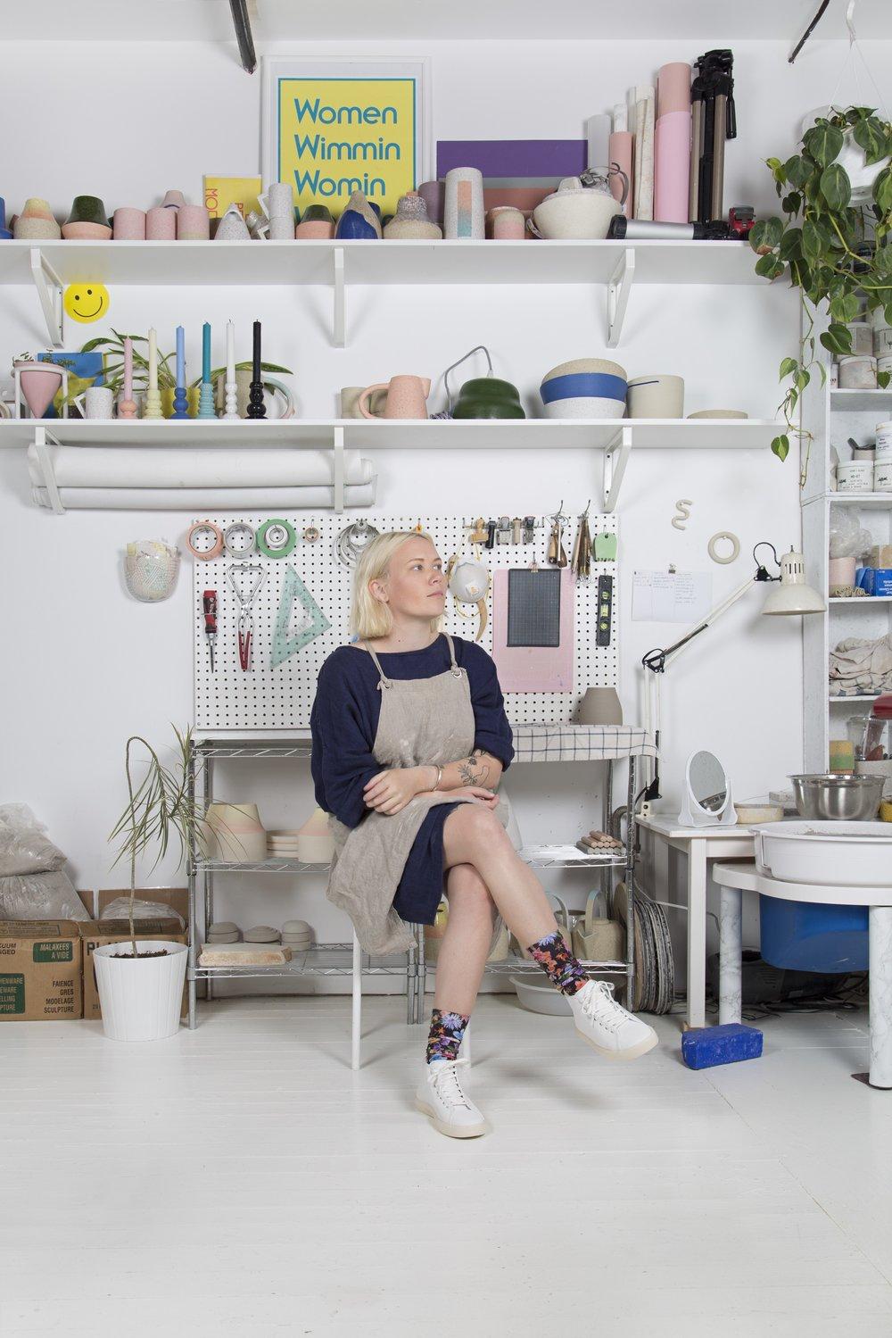 woman sitting on stool pondering